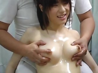 Young Japanese Babe Stodgy A Titty Massage
