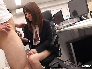 Naughty Asian co-worker Kimoko Tsuji gives a footjob plus blowjob in the office