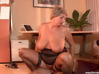 Dirty age-old slut Eva F. puts on stockings to seduce a younger guy