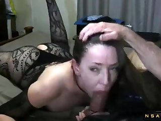 Kinky dark haired lady female parent in lingerie milks a dick with her lips