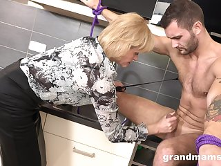 Domination mature woman is screwing young submissive dude