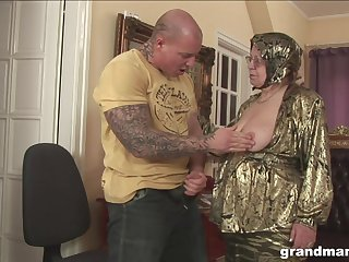 Rich granny is fucked and jizzed by enormous tattooed jock